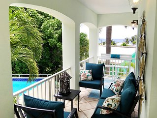 Walk to town. Poolside. Rennovated. View! 2 master suites! Private Yacht!