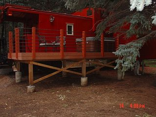Caboose Suite sleeps 2-3 (queen bed and single hide-a-bed).