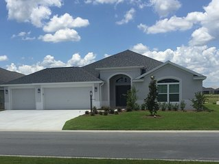 New home in quiet area with water view close to community pool.