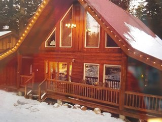 Log Cabin with Secluded Hot Tub Near Lake and Downtown
