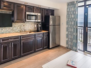 Modern clean oceanfront condo with tropical pools, tiki bar, heated indoor pool
