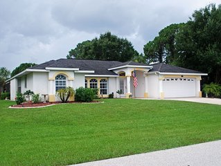 Gorgeous 4 BR Heated Pool Home on Golf Course with Lots of Privacy
