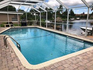 Waterside 3BR w/ Outdoor Heated Solar Pool, Dock, Lanai & Gourmet Kitchen