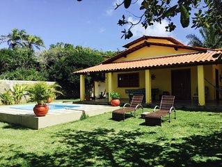 Charmosa casa na praia com piscina privada, terreno de 8500m2 de Mata Atlantica