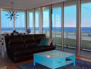 Floor To Ceiling Windows Overlook The Gulf Of Mexico's Pristine White Beaches