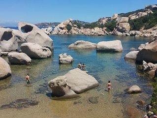 Casa con terrazzo panoramico,Villaggio sulla spiaggia con piscina -  Porto Pollo