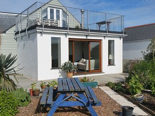 Spacious five bedroom house sleeps 10 close to Polzeath beach.