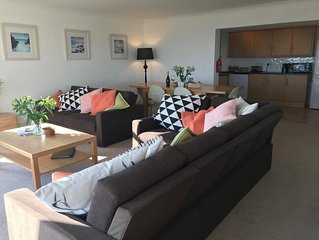 July Deals - Huge ground floor apartment - sleeps 10 with fabulous views to sea.