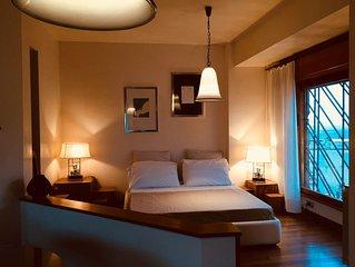 La Suite Tivoli - sleek and 70s stylish penthouse - in the earth of Tivoli