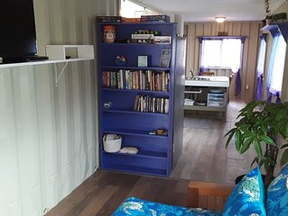 Enjoy a solar powered shipping container house experience in paradise!