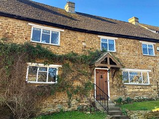 Bridge Hill Cottage - a picture-postcard Cotswold-stone house, in the village of