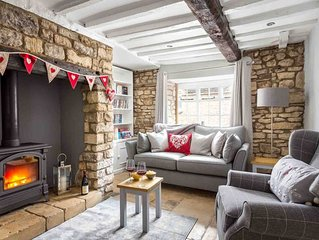 Miller's Cottage is one of a row of traditional Cotswold stone cottages in the h