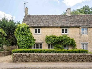 Winterberry Cottage is a traditional, semi-detached Cotswold stone property, wit