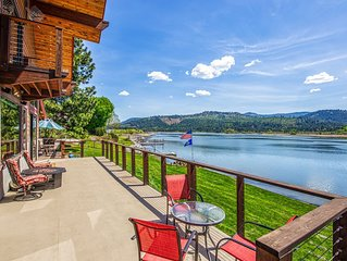 Custom-built riverfront home w/ private dock, game room, hot tub, heated floors!