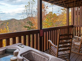 Mountain view cabin w/ shared pool, private hot tub, fireplaces, & game room