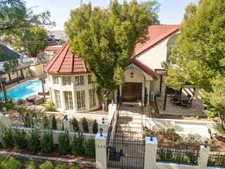 Mediterranean Mansion - heated pool, hot tub, theater room, center of the city!