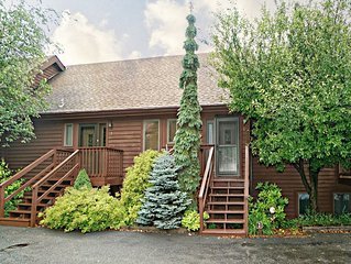 Lake access town home with dock slip, fireplace and community pool!