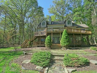 Lakefront home with private dock, sun room, and many community amenities!
