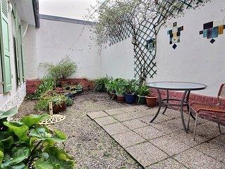 T3 avec jardin clos proche centre ville.