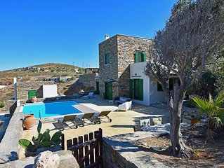 Stone built villa with a swimming pool and a sea view
