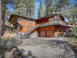 Modern cabin w/ a gas fireplace, spacious deck, & beautiful forest views