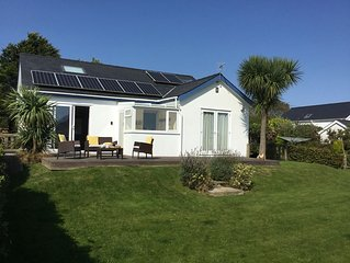 Nr Abersoch 4 bed home sleeping 8 sea views set in large family friendly garden