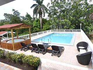 Comfy bedrooms with swimming pool plus free wifi, spa hut, bbq, 24-hour security