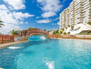 High-end resort condo w/ocean views & shared pool, gym, rec center & more!