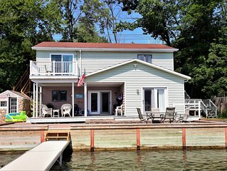 Updated lakefront cottage with a seasonal dock & 57-foot waterfront!