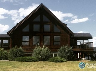 Large Log home on Acreage