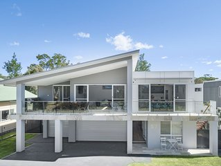A brand new, premium quality house on Narrawallee Beach.