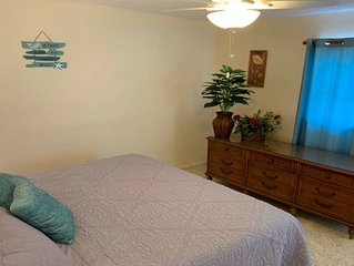 Spacious one bedroom with bonus Florida Room and private yard.