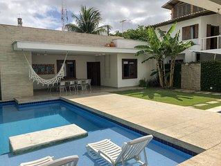 Bela casa na Barra de Sao Miguel - 50m da praia -4 suites - piscinas -12 pessoas