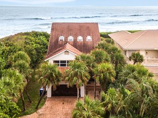 Three-level oceanfront home w/ a full kitchen, bar, balconies, & rooftop sundeck