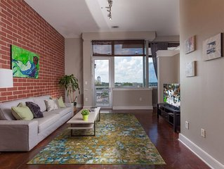 Breathtaking City Views | Walkable |  Free Parking | Central Uptown Location