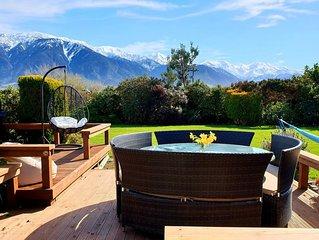 Can sleep 13 to 19 people with Stunning Mountain Views & Gardens