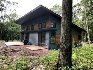 Beautiful new contemporary home on a quiet wooded lot minutes from Devils Lake