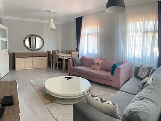 Feel yourselves at home in this fresh apartment in a clean family friendly area