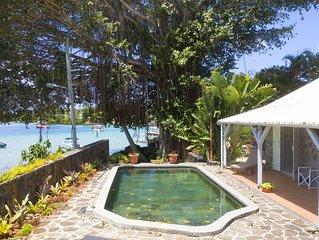 Villa privée pied dans l'eau piscine,jardin,femme de ménage cuisine,wifi gratuit