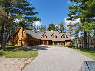 Private wooded lake front log cabin perfect for large groups