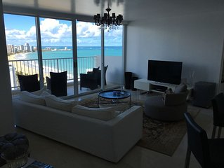 Luxurious and Stunning Condo on the gentle waves of Isla Verde Beach!