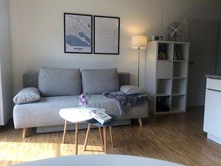 2 Zimmer Wohnung mit Seeblick und eigenem Garten
