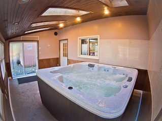 Cozy 5 bedroom split level home with a Large Swimming pool, an indoor hot tub,