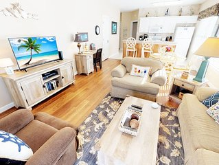 Charming Sunny End Unit Condo! Beach is less than 1.5 mi! - WE HAVE IT ALL!