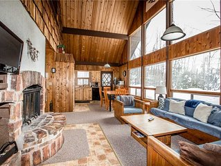 Vacation Home in a Quiet Wood Setting with Large Living Room and Brick Fireplace
