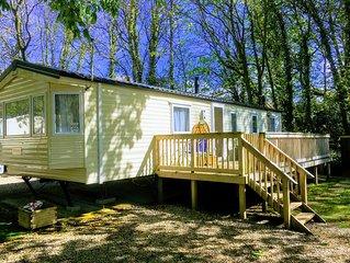 Quiet woodland retreat, extensive decking, within 2 miles of 3 pristine beaches