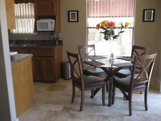 Dining area seats four with kitchen view