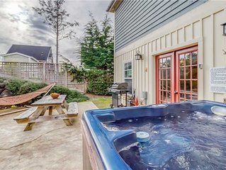 Amenities Galore in This Olivia Beach Cottage with Hot Tub, Carriage House & Kin