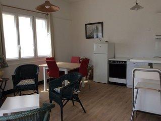 Appartement nouveau plein pied , 20m de la plage . Une place parking !