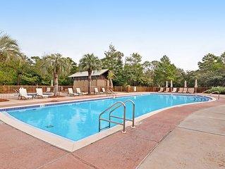 Open, airy, & bright condo w/ a shared pool, grilling area, private beach access
